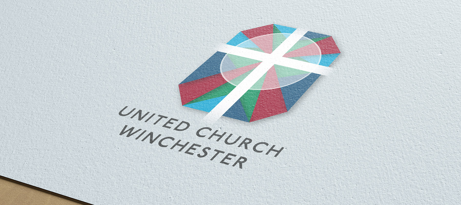 Large version of United Church logo at an angle printed paper